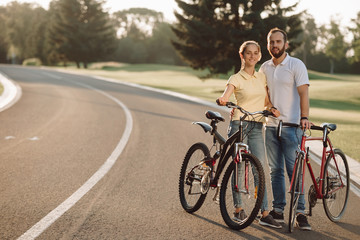 Couple of young cyclists on the road. Photo of couple having rest with bicycles. Active rest together.