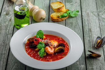 Delicious Italian tomato seafood on a table. Plate of classic healthy vegetable food.