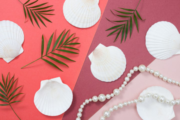 Tropical flat lay with seashells and pearls