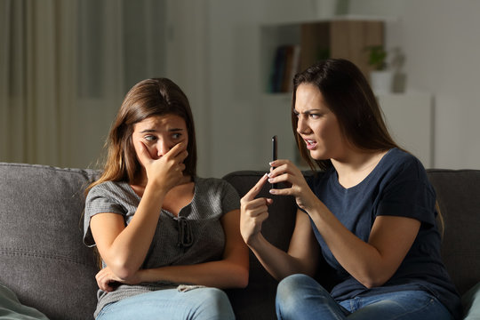 Woman scolding her friend about phone content