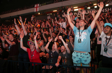 Fans react during the final day of the Rocket League Championship Series Finals in London