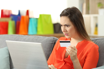 Shocked shopper buying online with credit card