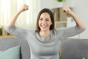 Strong and proud woman gesturling looking at you