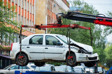 Car after the accident is raised for loading on the tow truck with a shallow depth of field