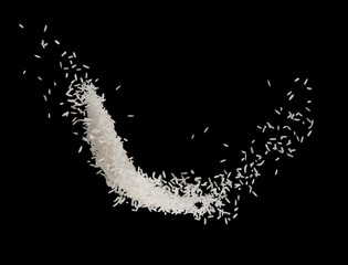 Stop motion white rice splash or explode flying in the air  isolated on black background food object design