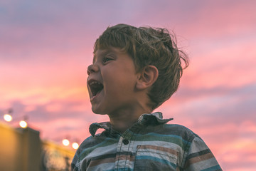 Excited Child with Sunset in Background