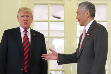 U.S. President Donald Trump and Singapore's Prime Minister Lee Hsien Loong shake hands during a meeting at the Istana in Singapore