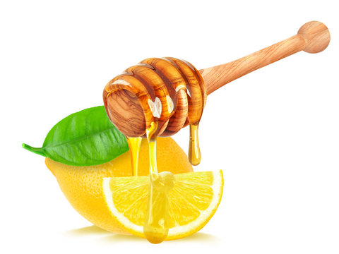 lemon and honey dripping isolated on white