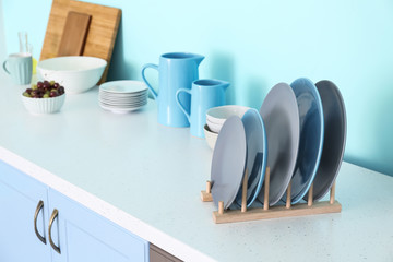 Plates on table in modern kitchen
