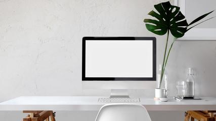 Loft workspace with mockup desktop computer and poster.