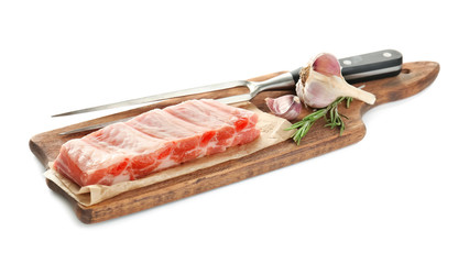 Wooden board with fresh raw ribs on white background