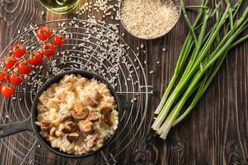 Composition with delicious risotto on wooden background
