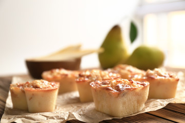 Delicious pastry with pear on table