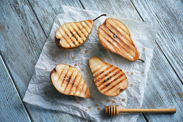 Tasty baked pears on table