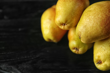 Delicious ripe pears on wooden table
