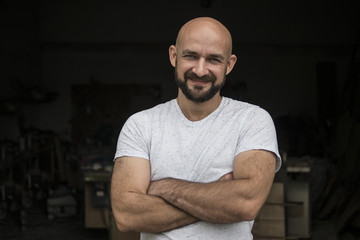 Portrait Of white bald carpenter with beard in white t-shirt. isolate on a black background