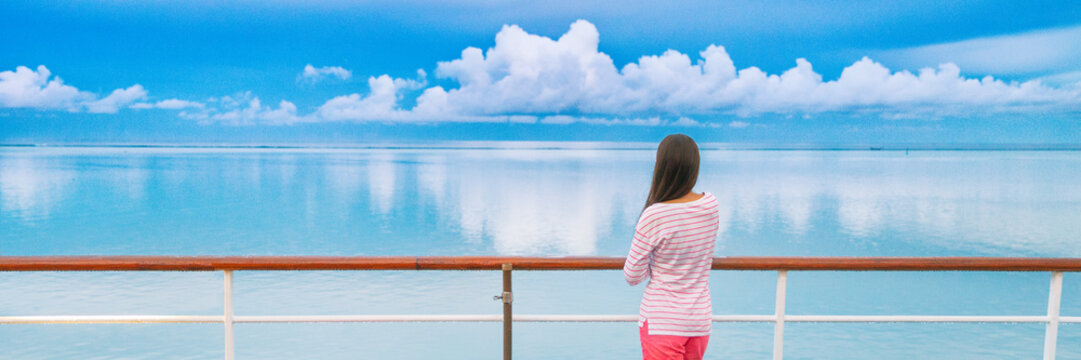 Cruise ship travel tourist woman on boat deck looking a peaceful summer night sky after rain. Serene still ocean water landscape. Tourism vacation holidays sailing away.