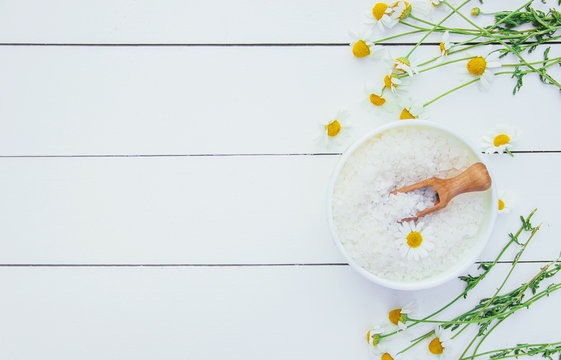 Spa sea salt with chamomile extract. Selective focus.