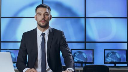 Male News Presenter in Broadcasting Studio.