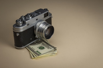 The camera on a pack of dollars is on the table