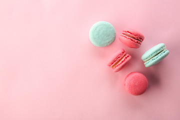 Tasty macarons on color background, top view Wall mural