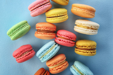Wall Murals Grass Delicious macarons on color background, top view