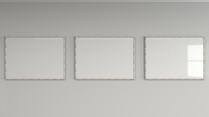 Blank white poster in wooden frame on the wall