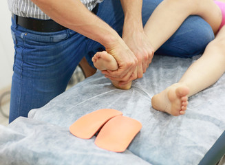 specialist dealing with  development problem   using orthopedic insoles
