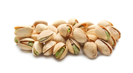 Tasty pistachio nuts on white background