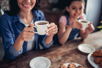 mother and daughter drinking tea