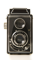 Old antique black photo camera on a white background
