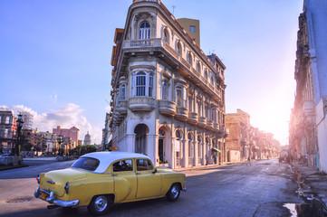 Poster de jardin Havana Street with old buildings and a retro car. Havana. Cuba.