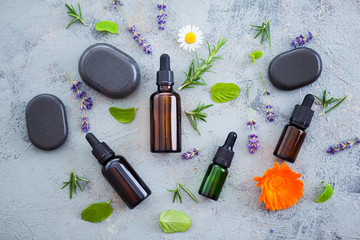 aromatherapy oil with fresh herbs and flowers