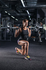 Sportive young woman in a gym training.