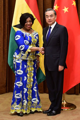 Ghana's Minister of Foreign Affairs Shirley Ayorkor Botchway shakes hands with China's Foreign Minister Wang Yi at the Foreign Ministry office in Beijing
