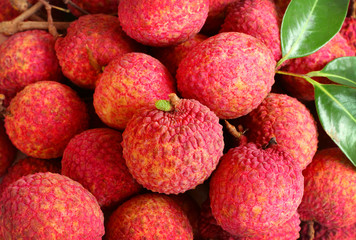 background of fresh red skin lychee with leaves.