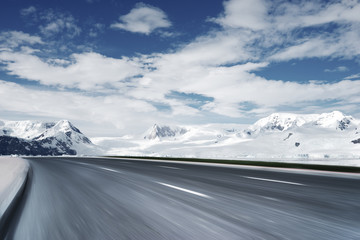 empty asphalt road with snow mountain