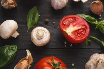 Fresh tomatoes and garlic closeup on rustic wood