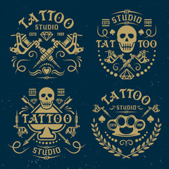 Tattoo studio vector emblems on dark blue backdrop