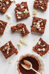 Pieces of vegan sweet potato brownie on white background, top view. Healthy vegan food concept.