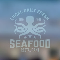 Seafood emblem with octopus on blured background