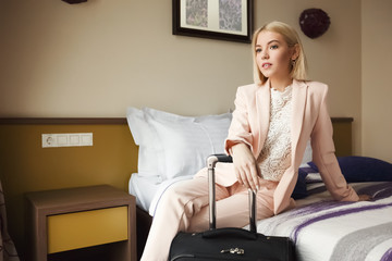 Young business woman sitting in the hotel room