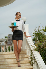 Waitress with tray and drinks