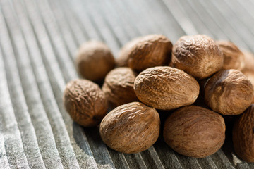 aromatic nutmeg on a gray wooden background