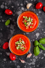 Italian red tomato cold gazpacho soup in glass, with cucumber, onion, Basil