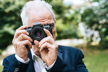 Mature man taking pictures