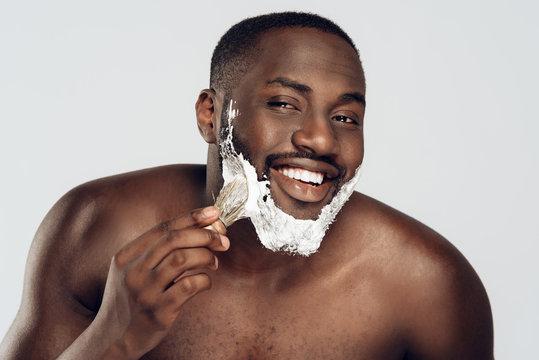 African American man smears shaving cream
