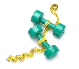 Dumbbells and measuring tape on white background