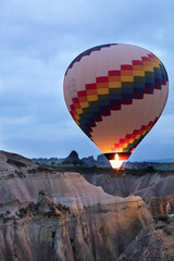 A balloon is flying over the valley in Cappadocia