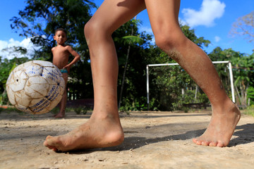 Children play soccer on Combu Island, near Belem, in the State of Para